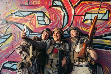 Selfie. group of soldiers taking selfie with smartphone