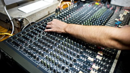 Hand on a sound mixer in a party