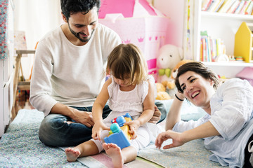 Caucasian family playing toys together