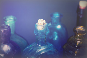 Old colourful bottles against a dark background