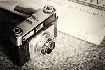 Old vintage retro camera with mocked up newspaper