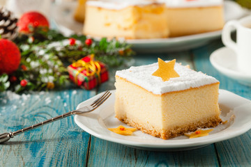 Delicious, traditional cheesecake. Christmas decoration.
