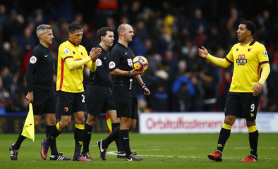 Referee Robert Madley at half time