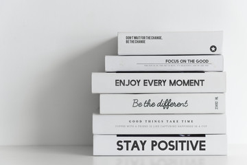 Books stack on white background Wall mural