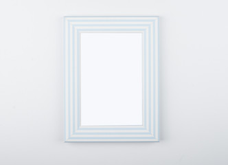 White and blue photo frame on white background. Isolated.