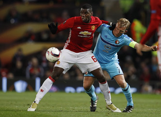 Manchester United's Paul Pogba in action with Feyenoord's Dirk Kuyt