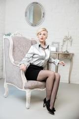Sexy woman in baroque interior