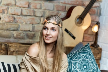 Beautiful young woman in hair wreath