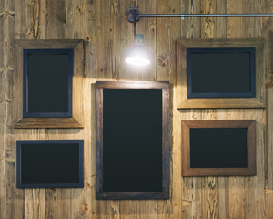 Chalk board wooden frame on wooden background with spot light