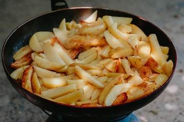 Fried potatoes in a frying pan