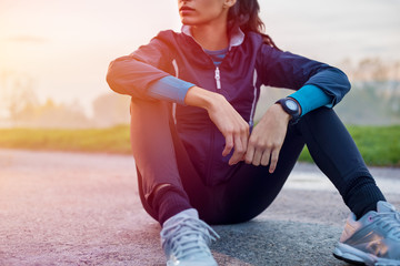 Athletic woman resting on ground