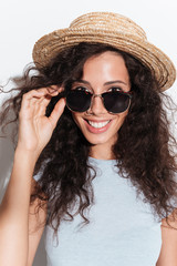 Portrait of young cheerful woman in sunglasses