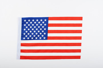 Studio shot of small bright USA flag lying on white background. Isolated.