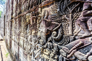 Bas relief at ancient Bayon temple in Angkor Thom, Siem Reap, Cambodia
