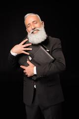 businessman embracing briefcase