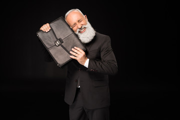 Excited businessman holding briefcase