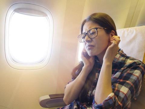lovely sweet female traveler feeling ear painful