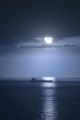 ship at night with moonlight