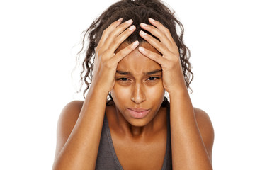 beautiful dark skinned girl with strong headache on white background