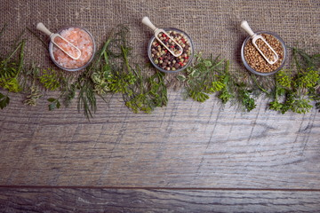 Vegetables, herbs and spices on an old wooden table, top view, copy space, rustic style. Vegetarian food, health or cooking concept