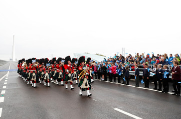 A military band marches during the ceremonial opening of the Queensferry Crossing bridge over the Firth of Forth in Scotland