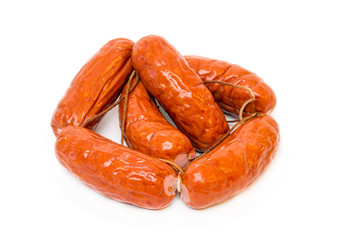 A bunch of meat sausages isolated on white background close up