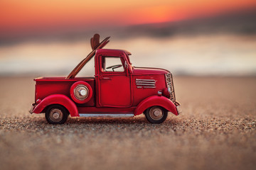 Sunrise on tropical island beach and car truck miniature