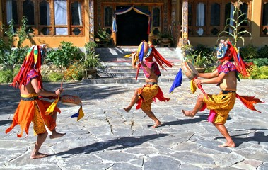 PARO, BHUTAN - November10, 2012 : Bhutanese dancers with colorful mask performs traditional dance at hotel in Paro, Bhutan