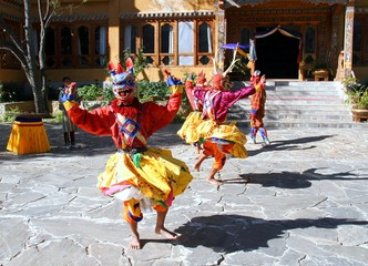 PARO, BHUTAN - November10, 2012 : Bhutanese dancers with colorful animal mask performs traditional dance at hotel in Paro, Bhutan