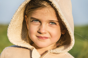 Girl wearing hooded jacket, portrait