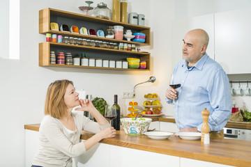 Senior couple talking in kitchen