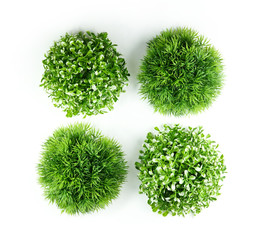 Artificial green grass in the shape of a ball sphere set isolated on a white background.