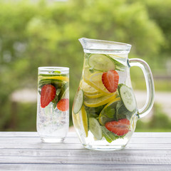 Dietary detox drink with lemon juice, red strawberry, cucumber and mint leaves
