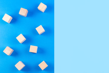 Wooden blocks on blue tone background.