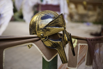 Golden gladiator helmet for protection in combat and war
