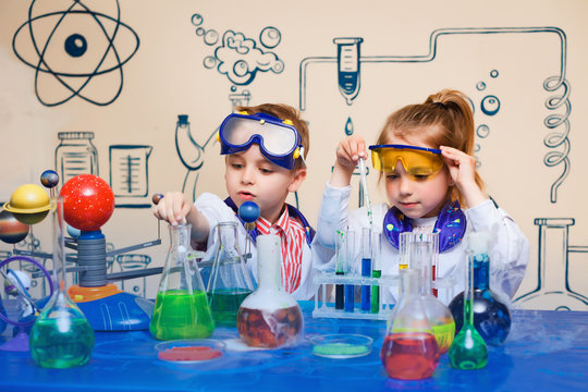 small children do chemical experiments. cheerful science,