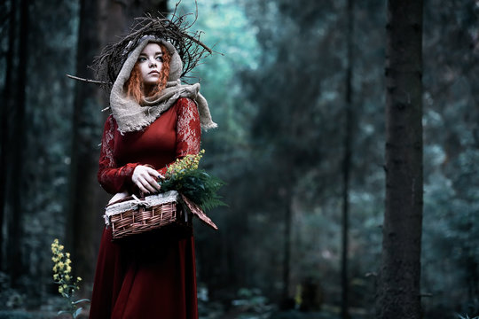 Red-haired witch in a dense forest