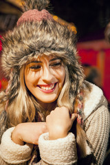 Woman with fur hat on Christmas Market