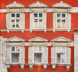 Facade of antique historical building. Windows with decorative stucco elements. Lviv, Ukraine. European travel photo.