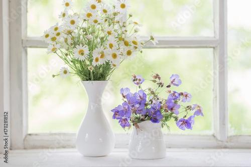 Flowers In Vases On Windowsill Stock Photo And Royalty Free Images