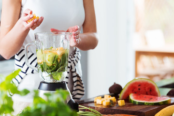 Woman preparing energetic smoothie