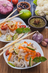 delicious Korean rice noodles with chicken.