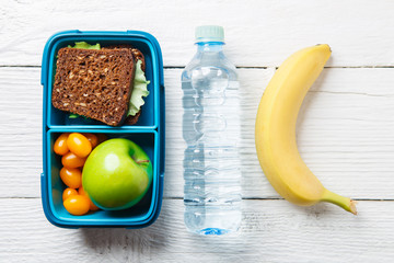 Photo of fitness breakfast in box, bottle of water
