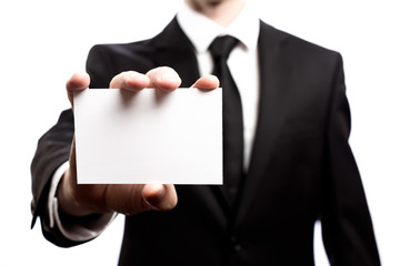Businessman with a blank business card isolated on a white background