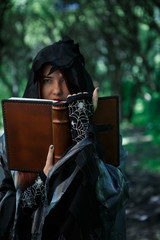 Photo of witch reading spell
