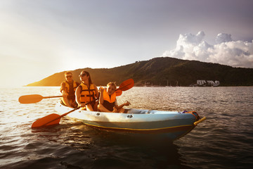 Family kayaking travel sea concept
