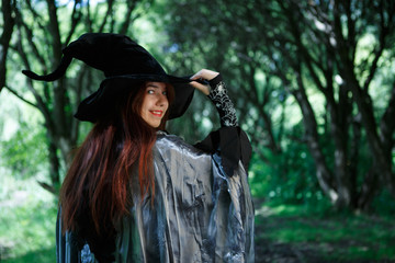 Photo of young witch in black hat