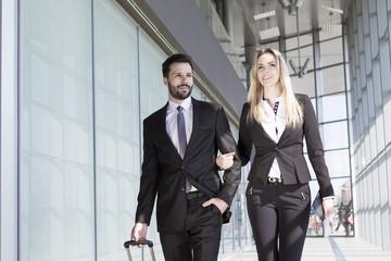 Business partners walking in modern lobby