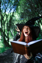 Picture of screaming witch in black hat