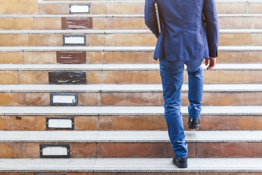 Businessman walking up the stairs